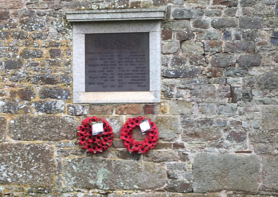 Original War Memorial on wall of Church Rooms showing 2 wreaths.