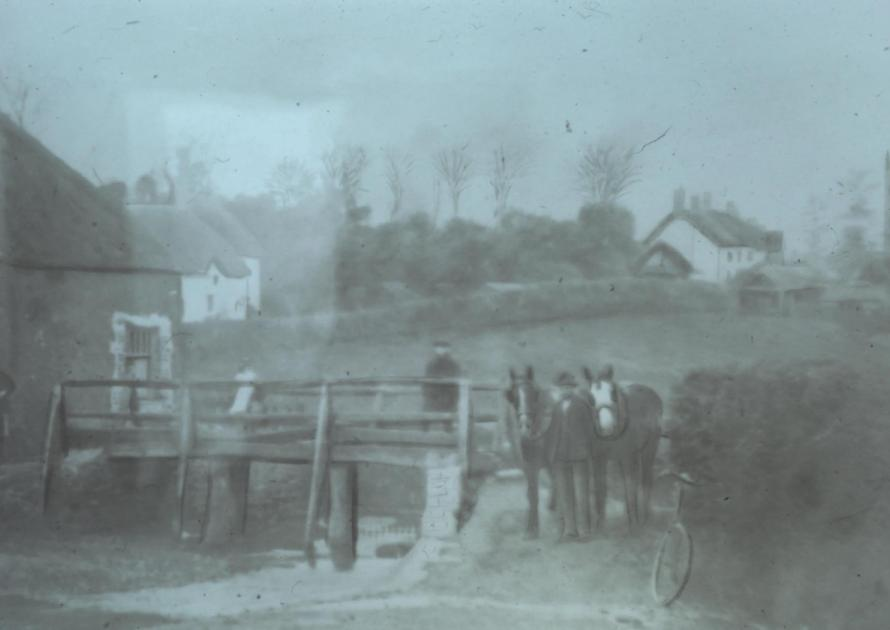 Old footbridge over ford and horses coming from Yond Hill