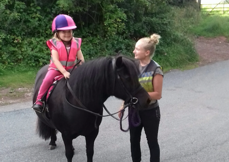 Annie Matravers leading Elsie aged 5 on a pony ride