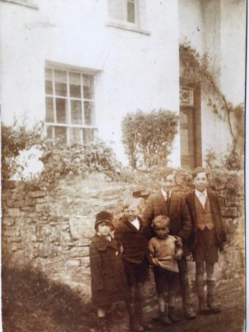 Snell family in road outside of Middletown