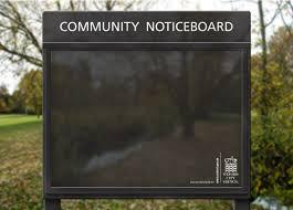 Picture of black notice board in a park