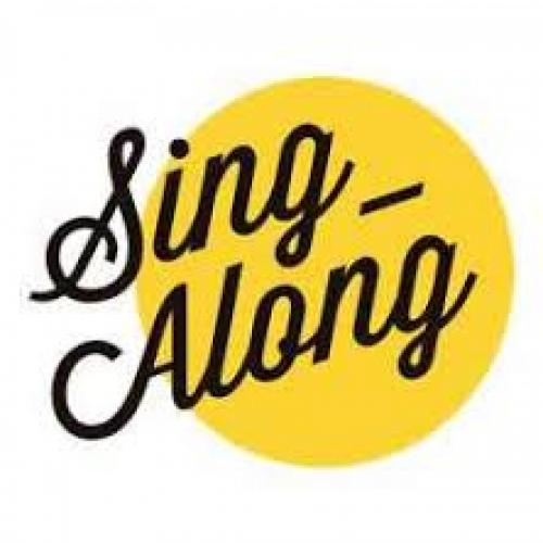 A yellow circular background with sing-along written across it
