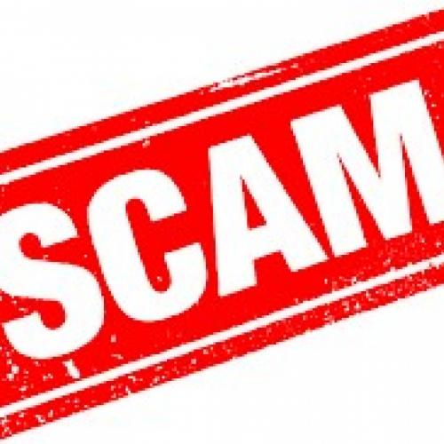 White lettering on a red background showing scam in capital letters